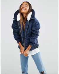 ASOS | Blue Puffer Jacket With Faux Fur Hood And Knitted Trim | Lyst