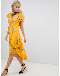 3dad0c0f1023 Free People Lost In You Floral Dip Hem Wrap Dress in Yellow - Lyst