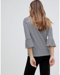 Soaked In Luxury - Blue Stripe Top With Fluted Sleeves - Lyst