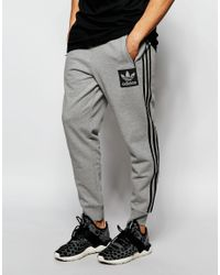 24366ca02af Lyst - adidas Originals Joggers With Patch Logo Aj9523 in Gray for Men