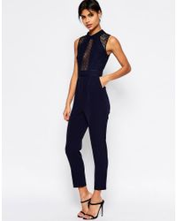 a8afd959e07 Lyst - ASOS Premium Lace Jumpsuit With Collar Detail in Blue