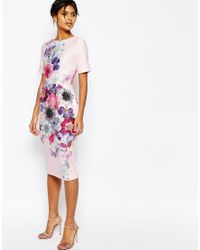 ASOS | Pink Textured Wiggle Dress In Placement Floral Print | Lyst