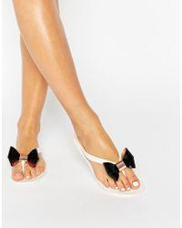8d2925b44 Ted Baker. Women s Ettiea Cream black Bow Jelly Flip Flops