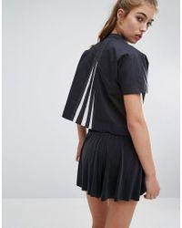Lyst adidas Originals top con pliegues Back In Black