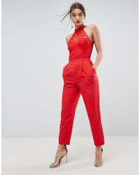 e419e13cf4 Lyst - ASOS Lace Top Jumpsuit With Halter Neck in Red