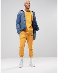 PUMA - Skinny Lounge Joggers In Yellow Exclusive To Asos for Men - Lyst