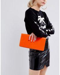 ASOS - Orange Long Structured Patent Clutch Bag - Lyst