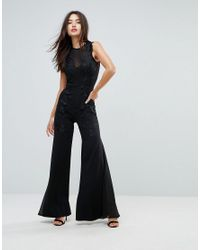 6ad7c90a29fb Lyst - Club L Wide Leg Embroidered Jumpsuit in Black