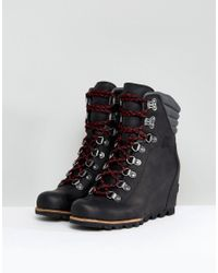 Sorel - Conquest Black Wedge Lace Up Boots - Lyst