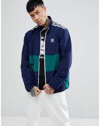 Adidas originali canzone giacca in marina cf5790 in blu per gli uomini.