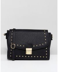 96cc336bcf Lyst - Yoki Fashion Yoki Studded Across Body Bag in Black