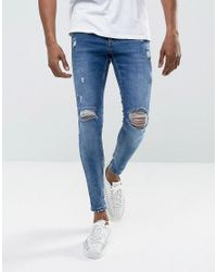 Gym King Super Skinny Jeans In Midwash Blue With Distressing in Blue ... 05b0c9166fdb