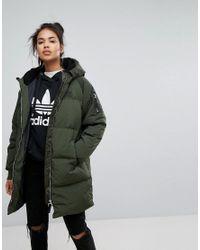 fbe63aa87eed adidas Originals Originals Long Bomber Jacket In Khaki in Green - Lyst