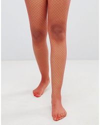68feaacb843 Monki Fishnet Tights in Red - Lyst