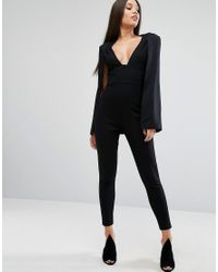 f36fba0bb2c Lyst - Lavish Alice Plunge Neck Jumpsuit With Cape Detail in Black