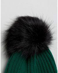 ASOS Asos Green Rib Beanie With Black Faux Fur Pom