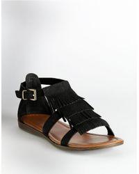 Minnetonka | Black Maui Fringe Sandals | Lyst