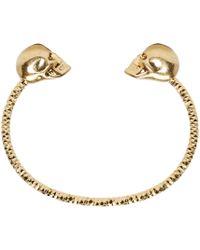 Alexander McQueen - Metallic Gold Twin Skull Bracelet - Lyst