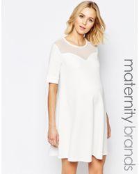 Bluebelle Maternity - White Mesh Insert Swing Dress - Lyst