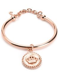 Juicy Couture | Pink Status Coin Bangle | Lyst