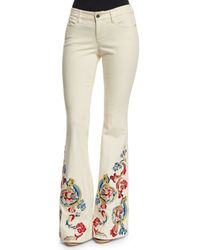 Alice + Olivia - Natural Ryley Low-rise Embroidered Flare Jeans - Lyst