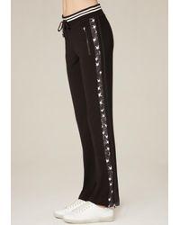 Bebe - Black Side Striped Track Pants - Lyst