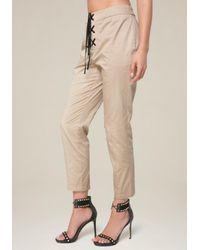 Bebe - Natural Front Lace Up Crop Pants - Lyst