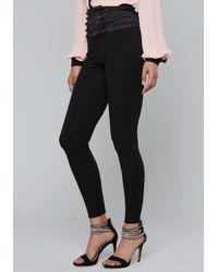 Bebe - Black Button Corset Leggings - Lyst