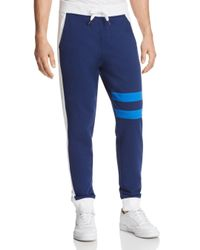 Calvin Klein - Blue Athletic College Stripe Sweatpants for Men - Lyst