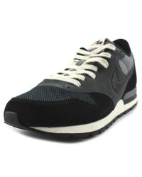 Nike | Black Epic Qs Women Round Toe Leather Sneakers | Lyst