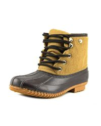 Tommy Hilfiger | Roan Women Round Toe Canvas Brown Rain Boot | Lyst