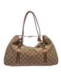 Gucci - Pre Owned - Bronze Monogram Metallic Canvas Leather Trim Shoulder Handbag - Lyst