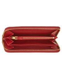 Prada - Red Saffiano Leather Triangle Zip Around Wallet - Lyst