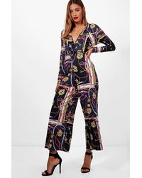 5c7c17ed963 Boohoo Wrap Front Chain Print Culotte Jumpsuit in Black - Lyst