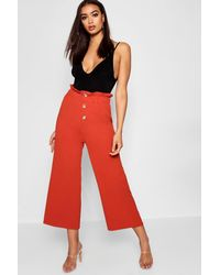 ce90917a7b28 Boohoo Crepe Mock Horn Button Paperbag Trouser in Red - Lyst