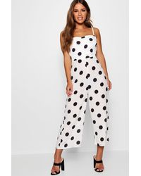 2e5c69410bc3 Boohoo Petite Em Polka Dot Square Neck Culotte Jumpsuit in White - Lyst