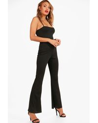 251f09503e5a Lyst - Boohoo Jeanie Flare Jumpsuit in Black