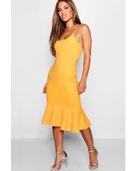 60a8fc27acfb Lyst - Boohoo Petite Strappy Ruffle Hem Midi Dress in Yellow