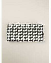 lyst michael michael kors jet set travel houndstooth wallet in black rh lyst com