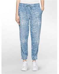 d98cdcc3b3 Calvin Klein. Women s Blue Jeans Faded Abstract Cloud Drawstring ...