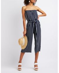 8e0a7bcd7e0 Lyst - Charlotte Russe Striped Strapless Jumpsuit in Blue