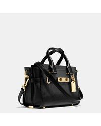 COACH | Black Swagger 20 In Pebble Leather | Lyst