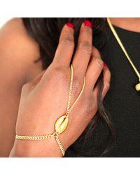 Rokus - Metallic Cowrie Handlet Bracelet - Lyst