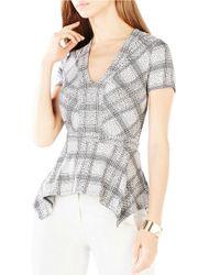 BCBGMAXAZRIA | Black Maebelle Knit Peplum Top | Lyst
