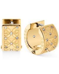 Michael Kors | Metallic Gold-Tone Pavé Monogrammed Huggie Earrings | Lyst