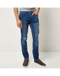 River Island - Mid Blue Wash Ripped Sid Skinny Jeans for Men - Lyst