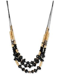 Kenneth Cole | Metallic Gold-tone Multi-bead Black Cord Layer Necklace | Lyst