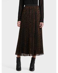 6091d4d58 DKNY Leopard-print Pleated Chiffon Maxi Skirt in Black - Lyst