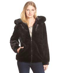 Gallery | Black Grooved Faux Fur Hooded Jacket | Lyst