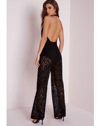 Missguided - Lace Wrap Halterneck Jumpsuit Black - Lyst